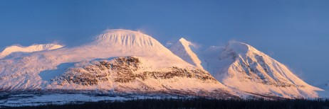 The famous mountain Ahkka in the last sunlight of a windy, winters day. Lapland, Sweden.