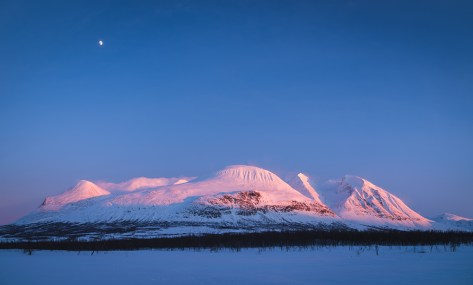 The famous mountain Ahkka, sometimes called the queen of Lapland, in the last sunlight of a winters day. Lapland, Sweden.