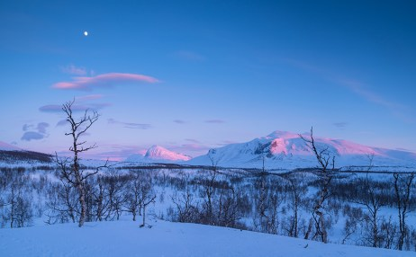 Arctic landscape with the mountains Nijak and Gisuris in the last sunlight of a winters day.