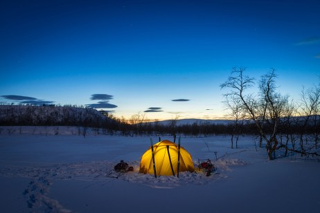 Twilight at my tent in the snow of an arctic wilderness of Lapland.