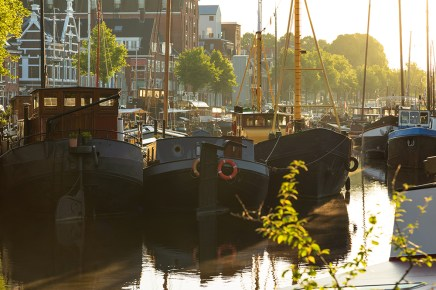 Ships and boats in the Noorderhaven during a tranquil summer sunrise.