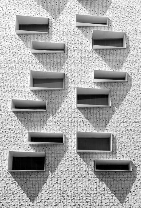 Windows and shadows on a modern facade.
