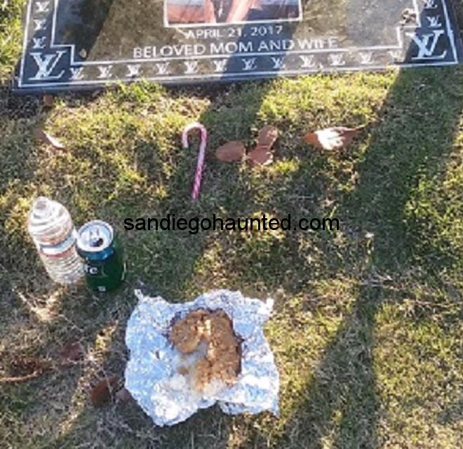 Fried chicken and drinks gift left for the dead at this grave.