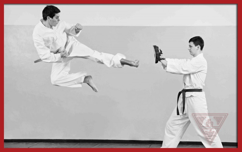 Karate Practitioner Doing Flying Kick