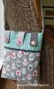 Sandra Healy Designs Button Tab Messenger Bag Bird Bag on Chair