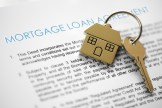House keys over mortgage loan document