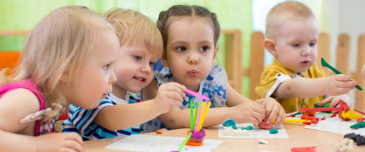 Kids group making arts and crafts in a daycare