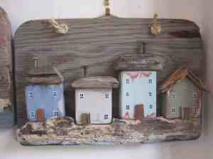 Driftwood painted sculpture of seaside cottages, hand-made by Sandy Kendall