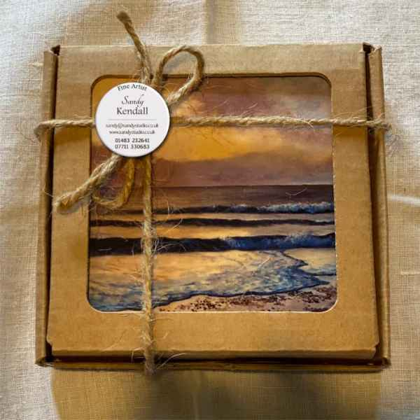 photo of set of coasters in display box, tied with natural string