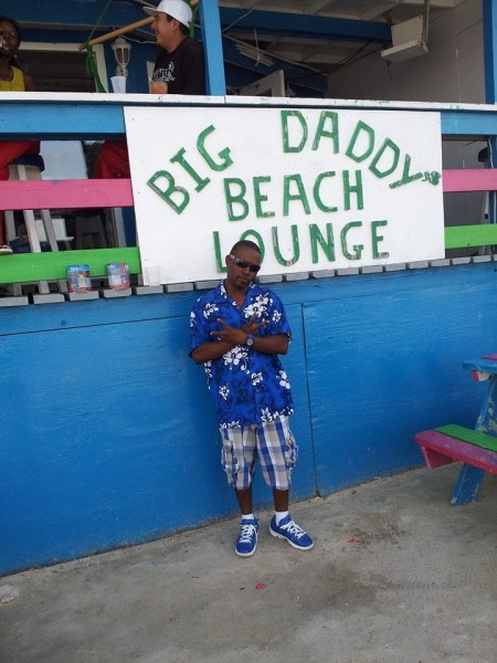 """Smurf"" posing in front of Big Daddy's Beach Lounge"