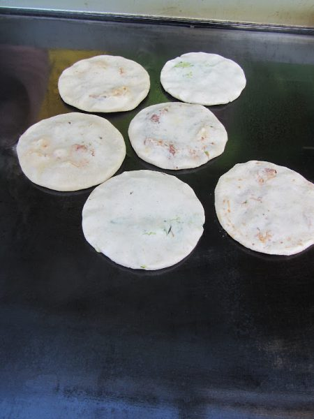 Pupusas on the griddle Middle Street San Pedro Belize