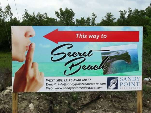 secret-beach-sign