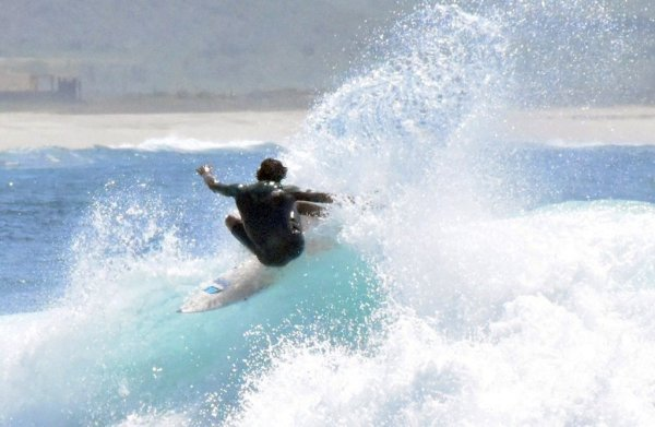 Surfing at Solo Sports at Punta San Carlos Surf Camp in Baja California, Mexico