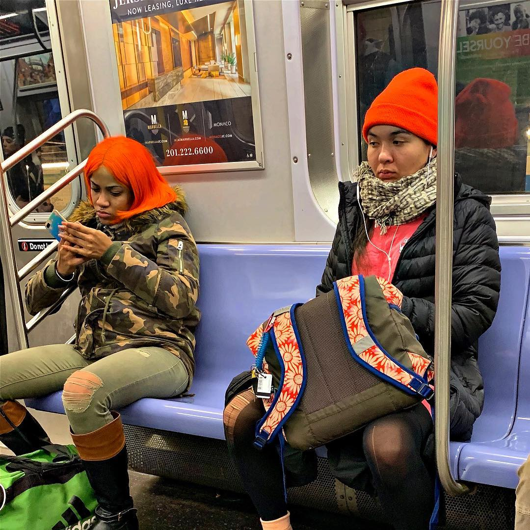 Matchy-matchy. #samesamebutdifferent #twinning #strangersonatrain #latergram #subwaystories #nyc #orange