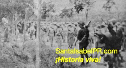 Prisioneros españoles son llevados al campamento en el barrio Descalabrado.