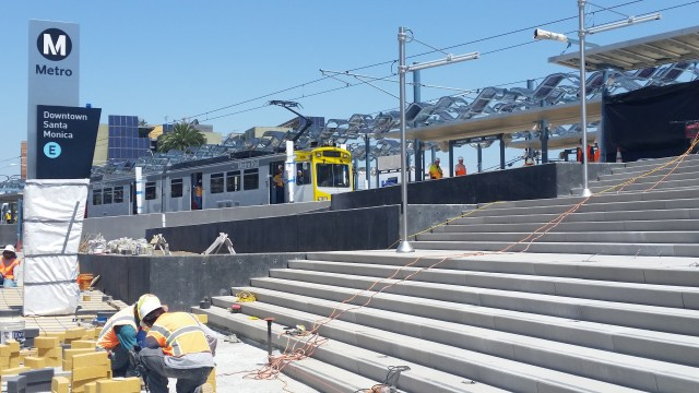 The first train pulls into the Expo Line Downtown Santa Monica station during clearance testing.