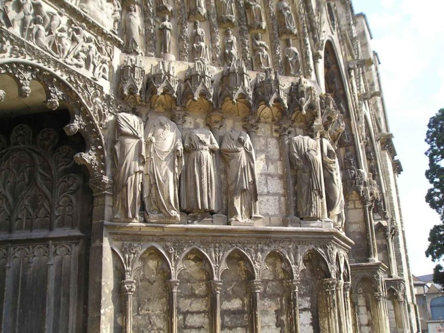 Statues stand with their heads removed at the Cathédrale Saint-Étienne de Bourges, France.
