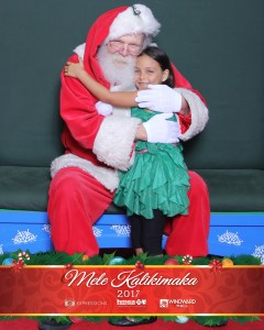 Photo of author's daughter with Santa
