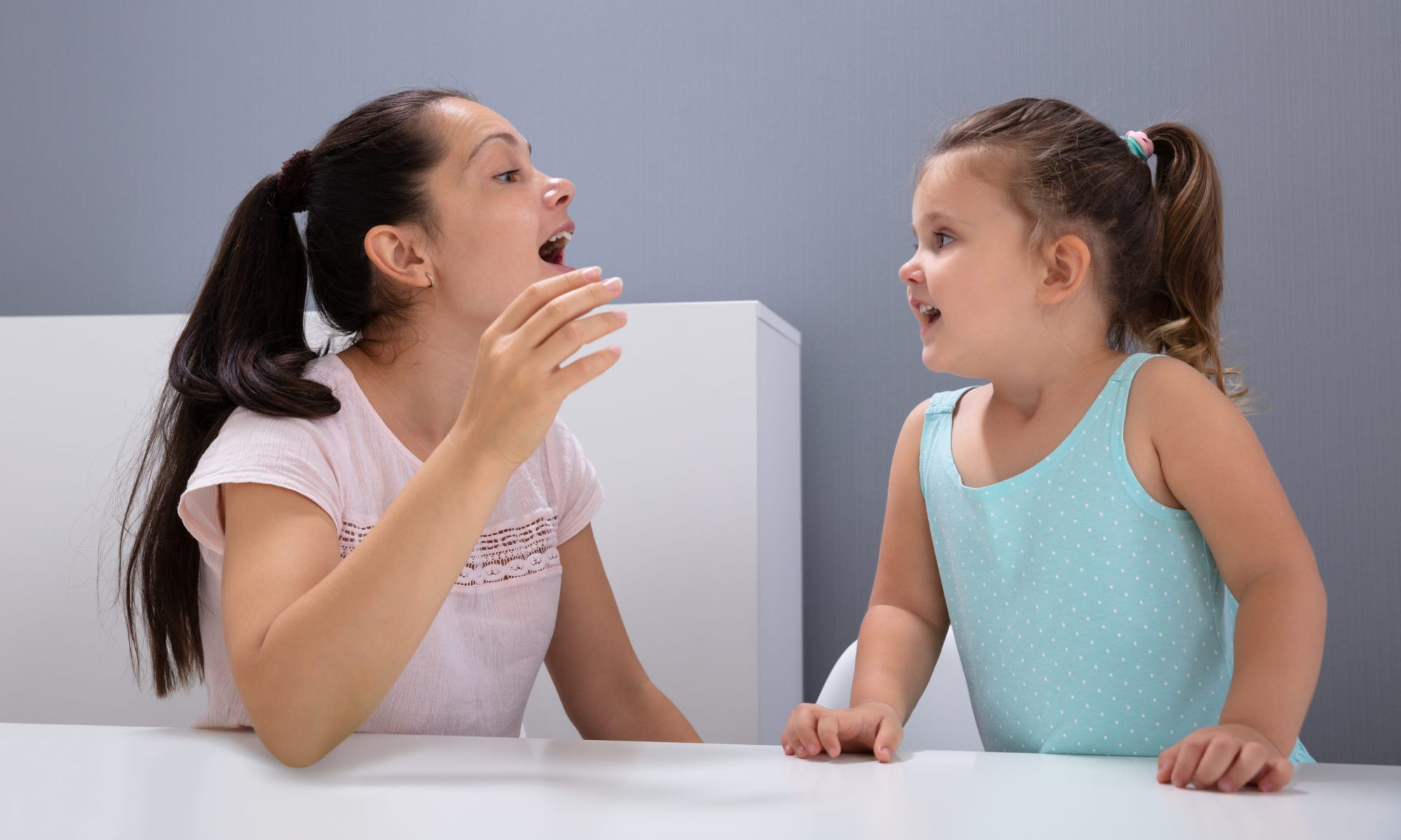 Speech Therapist Helps The Girl How To Pronounce The Sounds