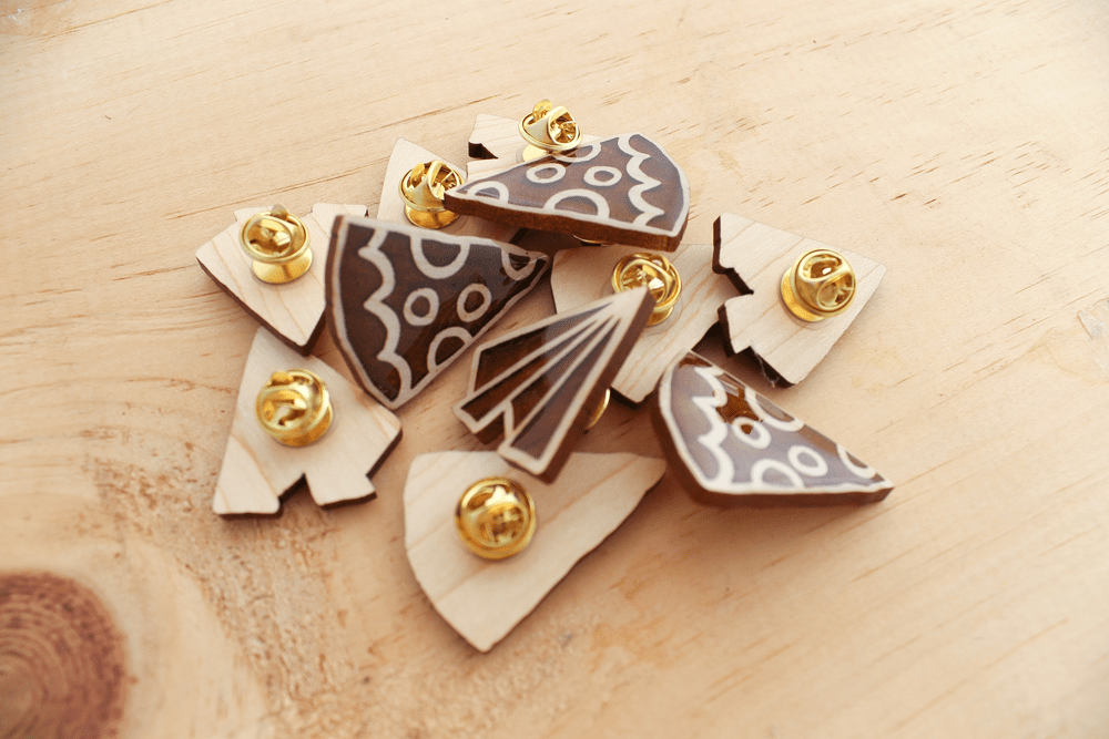Enamel pins made with the Glowforge