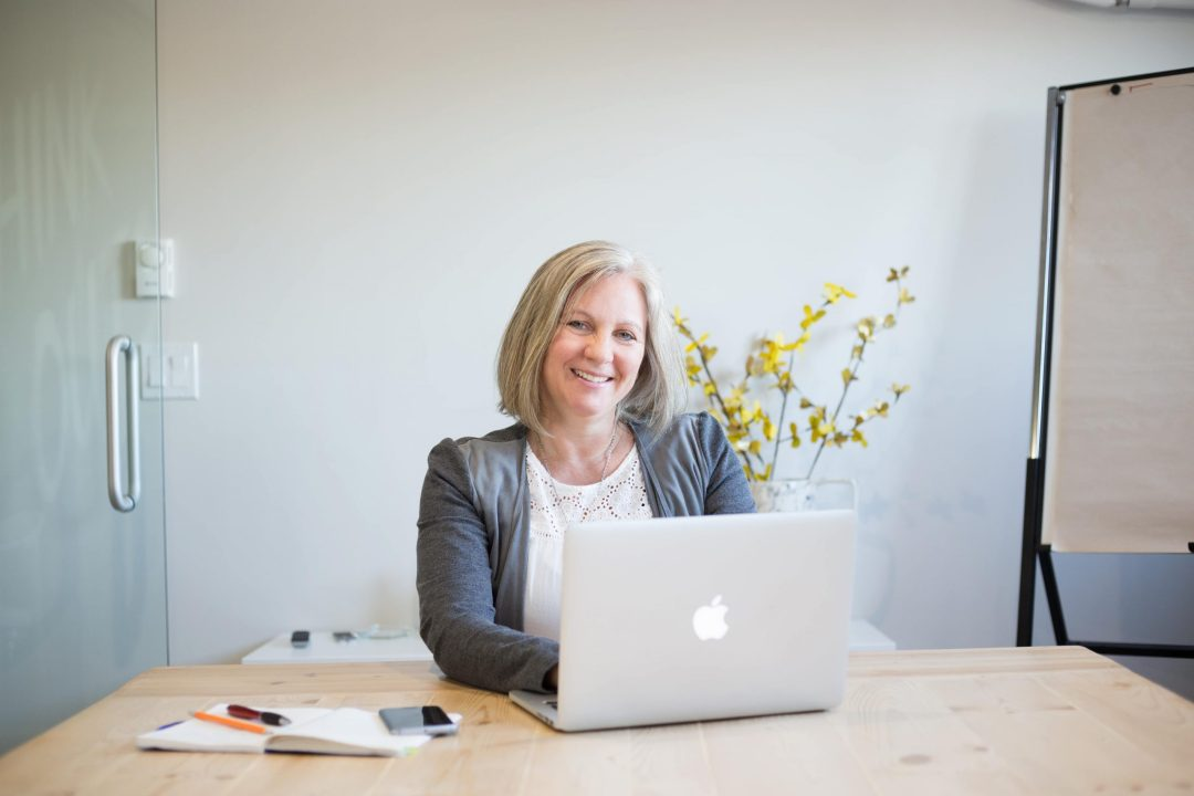 Headshot of Heather MacGregor at her laptop