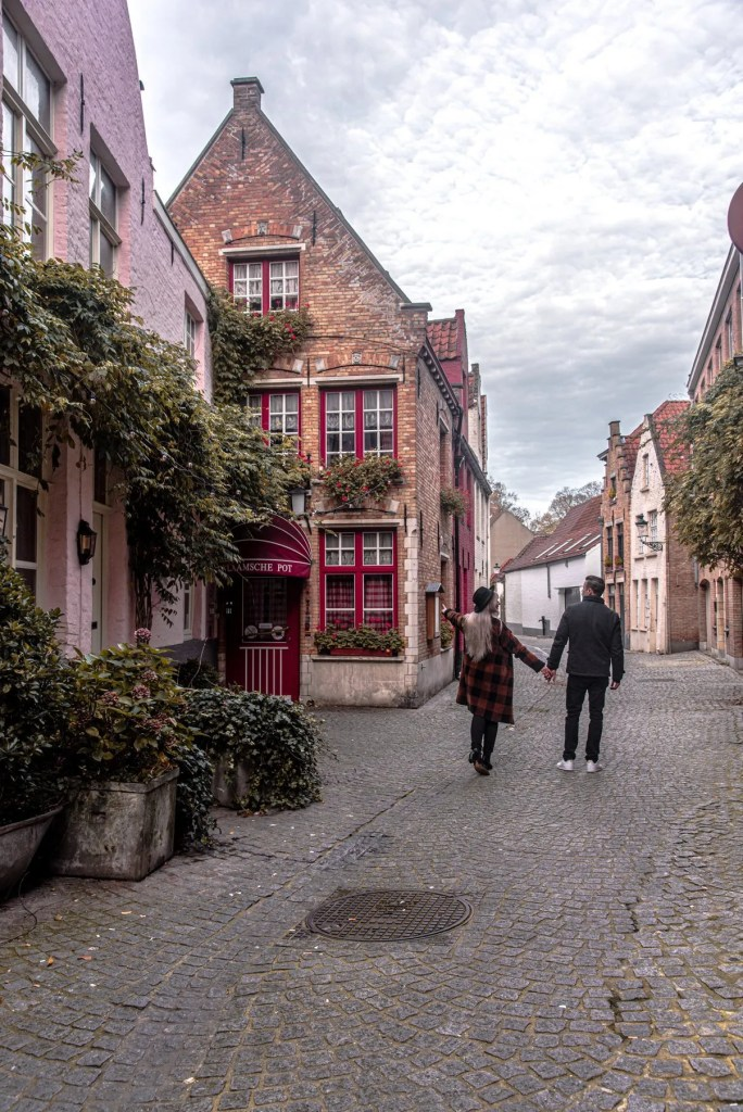 couple walking in Bruges Belgium