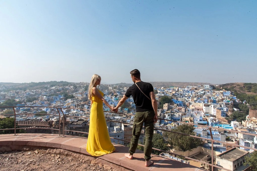 Couple staring at the view from viewpoint of Jodhpur in India