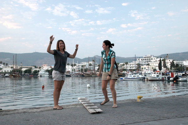 Overcoming Overwhelm: The Power of Happiness Course Review - Jumping for Joy (or attemping to) in Kos, Greece.