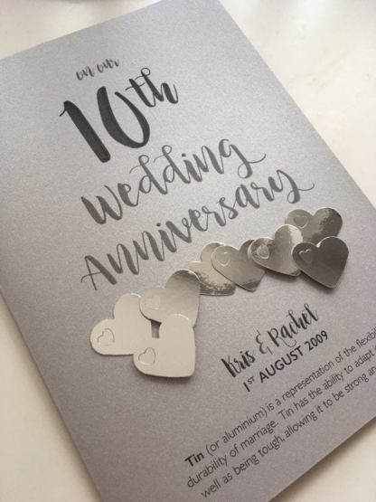 each card heart is embellished with tiny metallic hearts