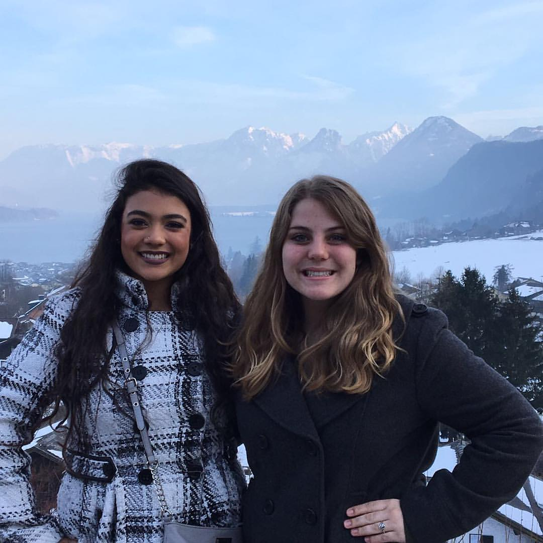 two girls standing in front of the mountainous Austrian countryside near Salzburg