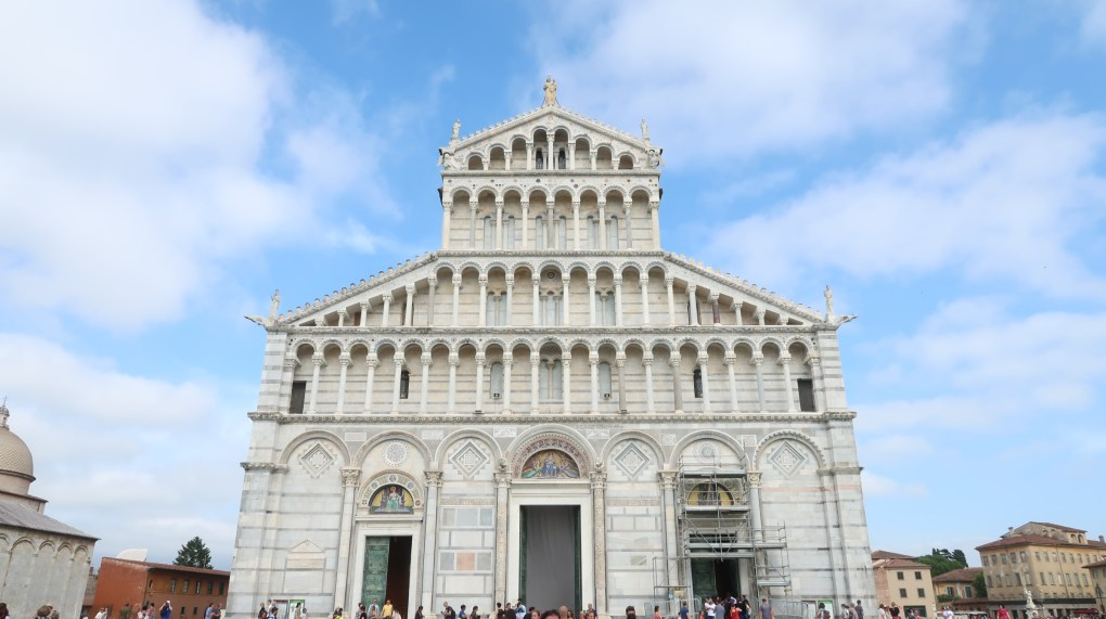 white church with blue sky in Pisa, Italy