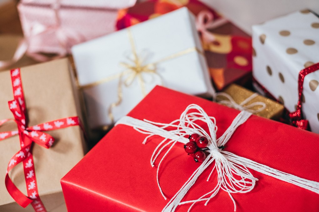 Christmas gifts wrapped in red, brown, and white papers