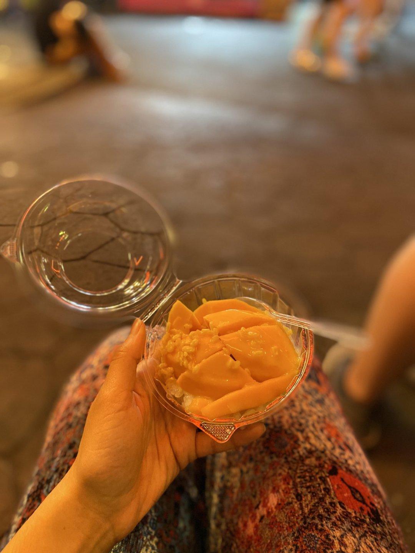 mango sticky rice from a food stall in Talad Rot Fai Train Night Market, Bangkok, Thailand