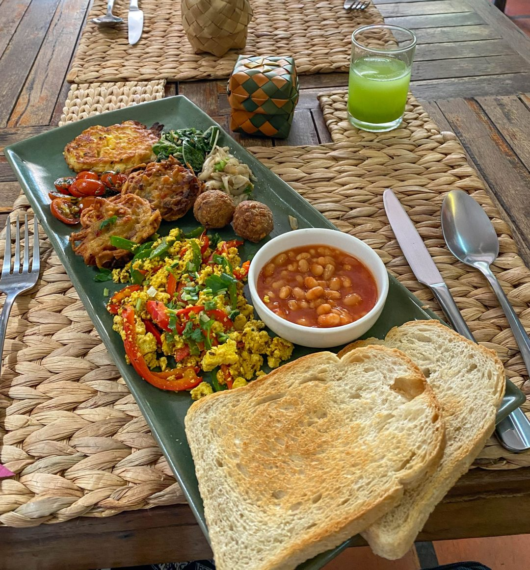 Vegan full breakfast with toast, beans, tofu scramble, tomatoes, etc. from New Leaf Eatery