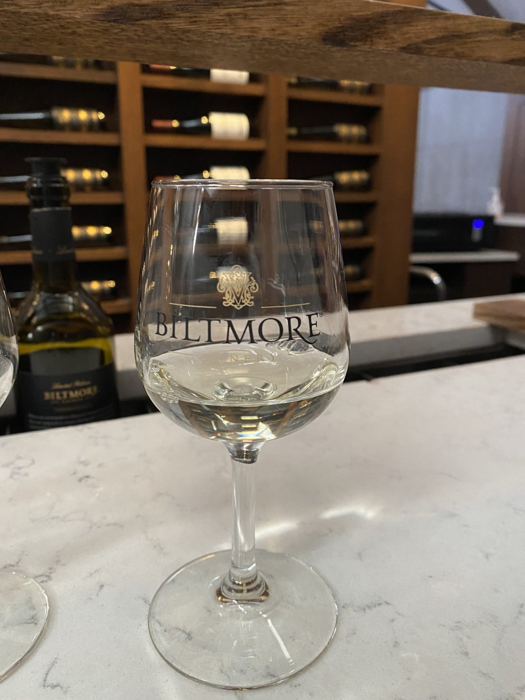 """Glass of white wine with """"Biltmore"""" written on it"""