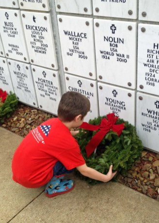 Laying a wreath for Ms. Tena's dad