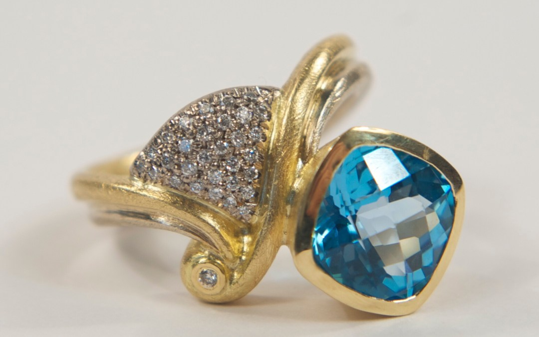Kathryns Wave Cocktail Ring: 18ct Yellow & White Gold set with Blue Topaz and Diamonds