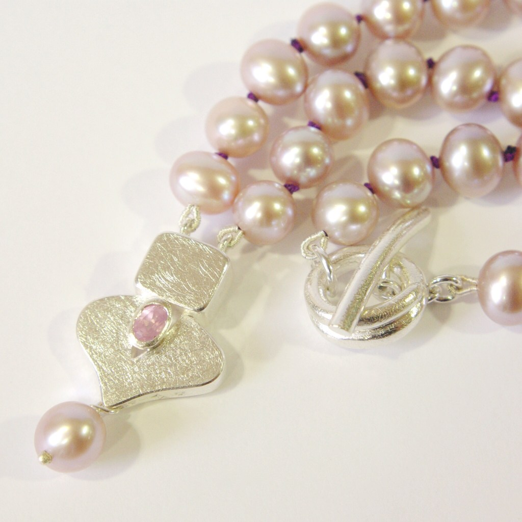 Pink Pearl Necklace With Frond Leaf Silver Pendant Set With A Pink Spinel | Sarah McAleer Jewellerysmith