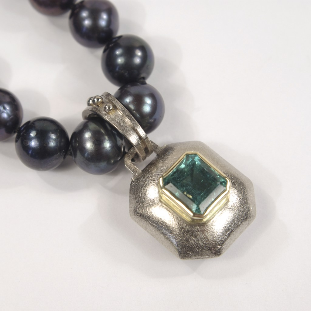 Heather's Emerald & Gold Pendant On Black Pearls