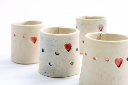 "four ""Home is…"" Tea Light Candle Holder"