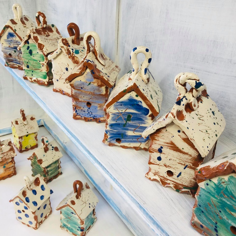 eastnor pottery studio shelves with slipware bug houses by sarah monk ceramics