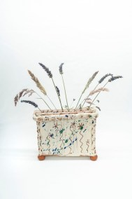 slipware flower brick by sarah monk in white slipware with sgrafitto daisies and real meadow grass