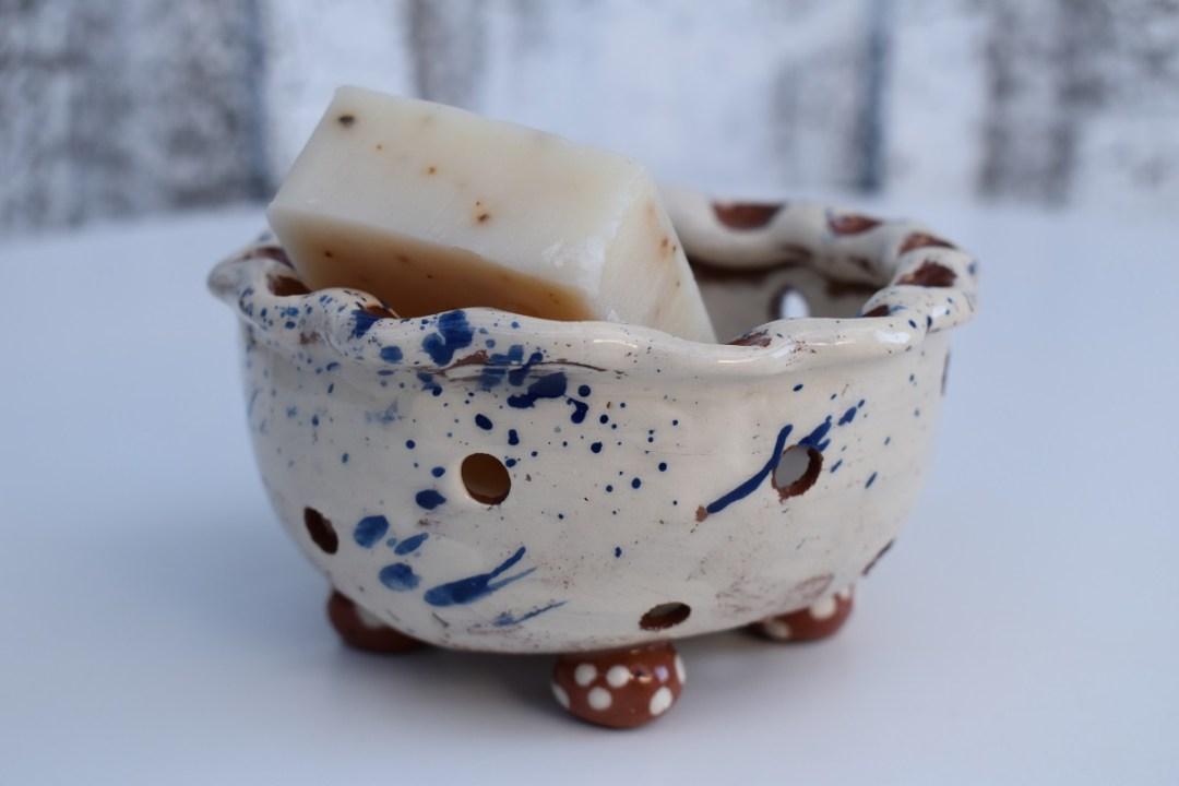 Slipware soap colander by Sarah Monk Ceramics in blue and white slipware with dotty round feet