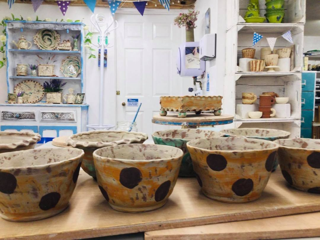 work in progress studio shot of slipware bowls decorated with bold brown dots by sarah monk ceramics