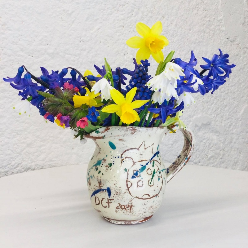 commemorative slipware jug made by sarah monk ceramics with fresh spring flowers
