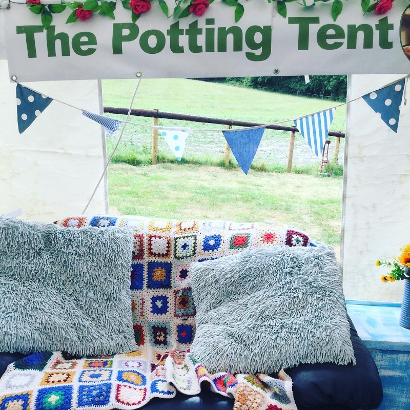 the potting tent sofa with field behind