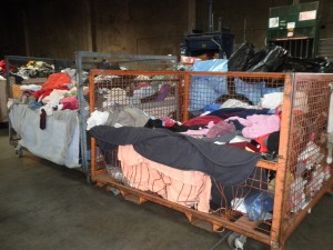 Bins of donated clothing