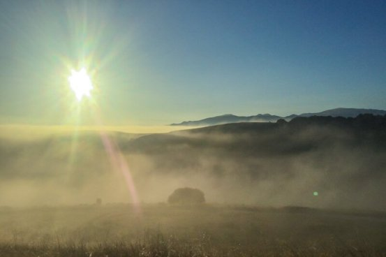 The morning fog burns off over Fort Ord
