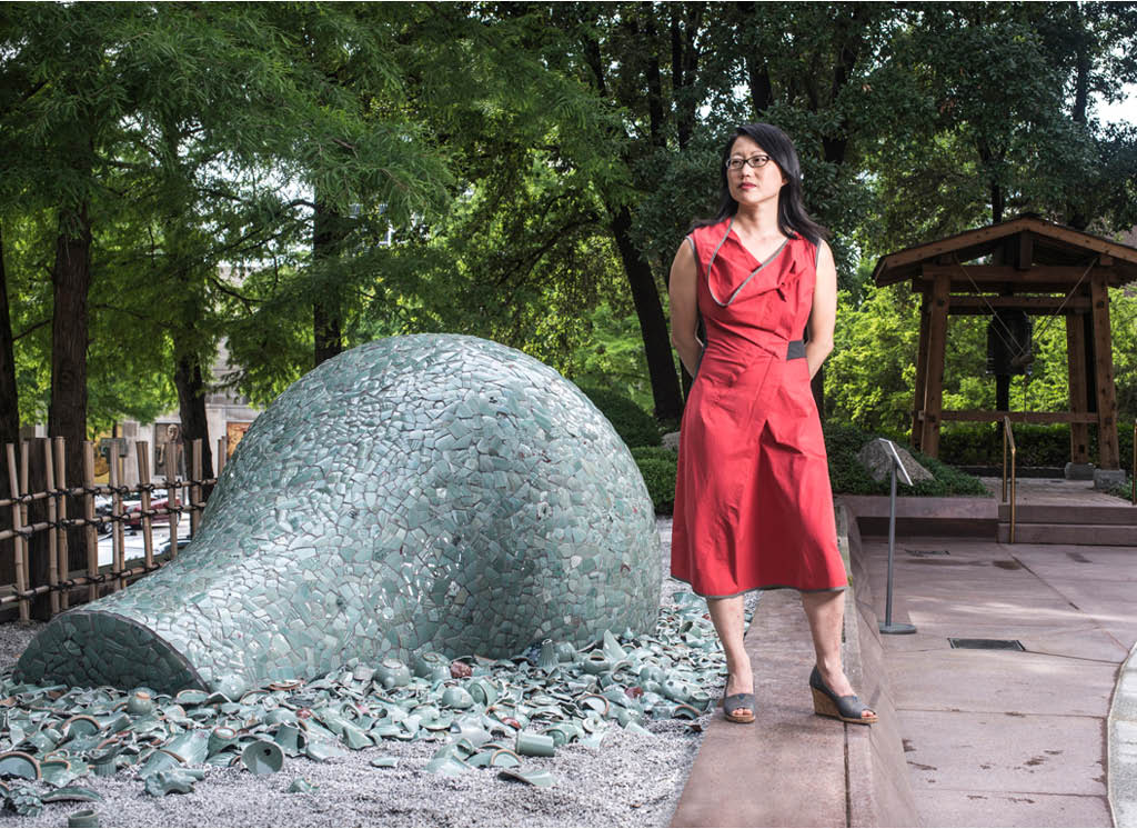 Artist Jean Shin poses with her installation Celadon Landscapes