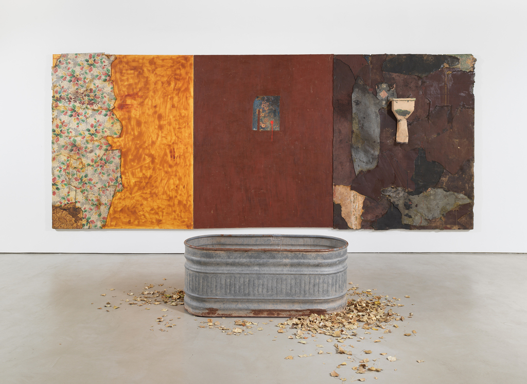Harmony Hammond Inappropriate Longings, 1992 Oil, acrylic, canvas, linoleum, latex rubber, metal gutter and water trough, dry leaves (triptych) 91h x 219w in. (231.14h x 556.26w cm) Courtesy of the artist and Alexander Gray Associates, New York Photo: Jeffrey Sturges © Harmony Hammond / VAGA at Artists Rights Society (ARS), NY